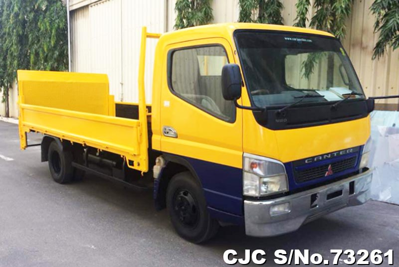 Yellow Mitsubishi Canter for Diplomats